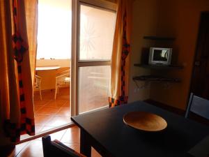 Ferien-Appartement-Strela-Maio-Blick-Essbereich-Loggia